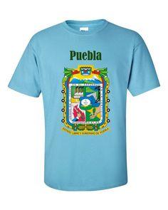 2000 Gildan® Ultra Cotton® Su típica 100 % camiseta de lagoon (excepto para los colores de brezo , que contienen 10% poliéster ). Pre -encogido para asegurarse de que su tamaño se mantiene a lo largo