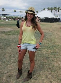 Coachella Festival Style: We love how this festivalgoer paired her H denim cutoffs and yellow tank with Western booties and a straw hat.