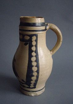 Antique stoneware pitcher with bird motif from Germany