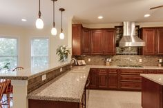 #Kitchen #remodel done by Granite Transformations. Features #granite counter tops and a #mosaic #tile back splash.