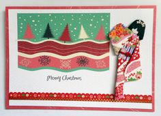 Handmade Christmas card, 3 layers, with hand-folded Japanese paper doll.  Materials: Japanese and Thai cardstocks; vector print from GraphicStock; Japanese decorative border; kimono (yuzen washi); obi (origami paper); viscose cord on obi; hair décor (nail art sticker).   Size: 15 cm x 10.5 cm