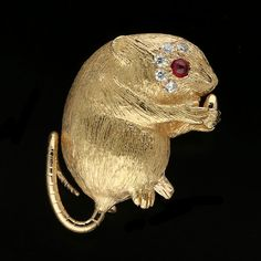A ROSE GOLD AND DIAMOND MOUSE BROOCH BY E. WOLFE & Co.	  The brooch…