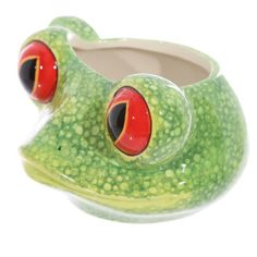 Tree Frog Shaped Ceramic Mug  Made from ceramics  Dimensions: Height 8cm Width 15.5cm Depth 12.5cm  Delivery prices available on Checkout