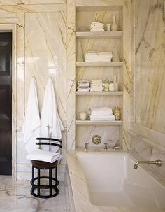 Practical and decorative, this recessed shelving at the end of a tub is great for keeping towels and bath amenities close at hand.