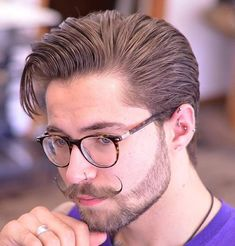 sleeked back medium hairstyle and hipster moustache