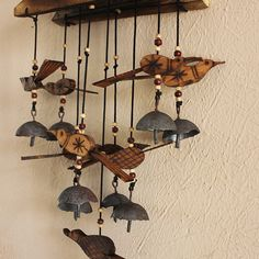Handcrafted bamboo and wood wind chimes with carved birds and copper bells made by skilled artisans from central India.  Shop this now at:  www.theindianweave.com USD 45.00 / Shipping worldwide