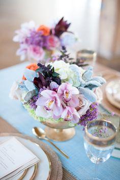 Gorgeous purple floral arrangement in a gold pedestal bowl. #wedding #flowers #centerpiece