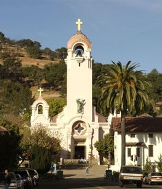 """Mission San Rafael Arcángel was founded in 1817 as a medical asistencia (""""sub-mission"""") of Mission San Francisco de Asís. It was a hospital to treat sick Native Americans, making it Alta California's first sanitarium.  Saint Rafael Church with Mission Replica to Right, San Rafael, Marin, California."""