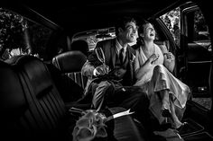 In the Limo. Black and white wedding photos.