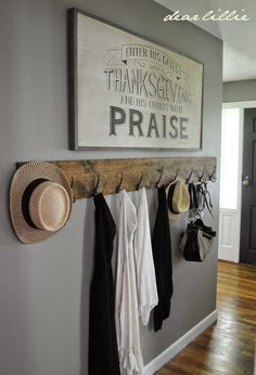 From Dear Lillie... 1x8 piece of wood (6 ft long) stained. Add hooks from IKEA.