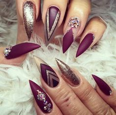 Burgandy and gold stiletto nails