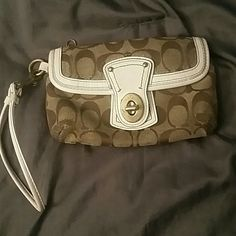 "Coach Wristlet Authentic Coach wristlet in tan, white and gold. Good condition with mild wear. Multi compartment. Approximately 7"" across. Coach Bags Clutches & Wristlets"