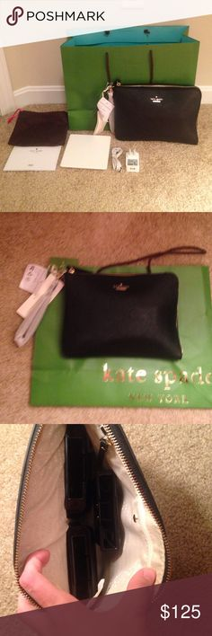 kate spade x everpurse New York quentin wristlet pouch with removable wristlet strap • interior zip pocket and charging dock • charges all iPhone devices • saffiano leather with matching trim • Kate spade New York gold embossed signature with stud kate spade Bags Clutches & Wristlets