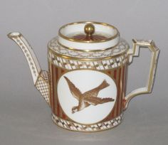 A FINE COALPORT PORCELAIN TEAPOT, CIRCA 1810. Of straight sided cylindrical form with angular spout and handle. Decorated with gilt geometric patterns & decorative motifs, the main body with two round opposed panels with sepia painted birds in flight within a gilt and burnt orange vertical striped band.
