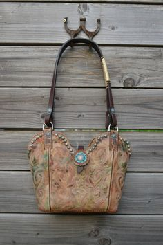 Hand made leather western purse made from Cowboy boots. Made in USA by Diamond 57 leather goods. #cowboybootpurse #cowboybootbag #cowboyboots #cowgirlboots #cowgirlswagger #cowgirlfashion #madeinUSA #handmadewesternpurse #westernbag #cowgirlswag #cowgirlswagger