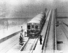On the Douglas 'L' tracks at Ashland Avenue and Congress Expressway, workmen who can barely see because of the snow try to free a frozen switch that has halted service on the line on Jan. 24, 1979.