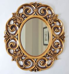 An impressive Ornate style very decorative oval wall mirror. Designed to hang in either portrait or landscape orientation and finished here in an antique gold painted finish with bronze shading. This item is also available in antique silver, matt black, copper and matt white finish. Overall measurements for this mirror are 3ft x 2 ft 8 (91cm x 81cm). This mirror is manufactured from a durable polyurethane mould, giving a sturdy but lightweight finish which in turn allows for easy wall…
