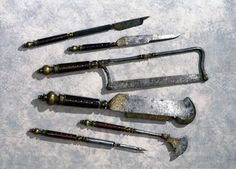 Hunting trousse, English, c 1570. This highly decorated set of steel instruments was probably used for carrying out amputations and for cutting up deer killed by hunting. In the 16th century the same set of steel instruments often had more than one use, serving for example as weapons, carving knives and surgical equipment.