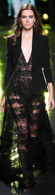 We love the delicate lace paired with masculine tailoring in this gothic dress from Elie Saab.