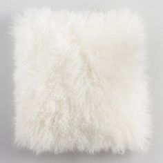 You'll adore how the heavenly softness and ivory hue of our genuine Mongolian lamb fur pillow with matching faux suede back brings a boutique look to your space for an exquisite value.