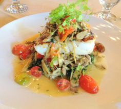 One of Chef Tanino's Daily Specials at Tanino Ristorante: Roasted Blue Nose Seas Bass served w/ Fresh Tomatoes, Artichokes, Mushroom Melange and Sautéed Spinach.