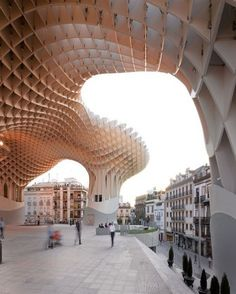 Metropol Parasol, a raised, ameba-shaped public space by J. Mayer H. in Seville, Spain, protects Roman ruins that were discovered during the construction of a bus station.
