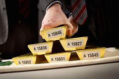 After sudden plunge, gold traders cry conspiracy