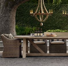 Provence Bucket Armchair and concrete and teak dining table from Restoration Hardware