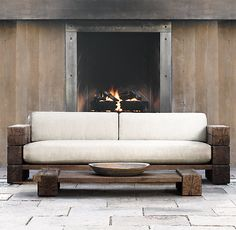 "RH's 63"" Aspen Sofa:We've interpreted the earthiness and strength of a Scandinavian artisan design by Søren Rose in the Aspen collection. Hewn from massive timbers of French oak, every piece celebrates nature in its rustic simplicity."
