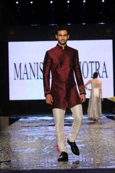 Manish Malhotra's Chinese collar and fine detailing on the sleeves brightens the sherwani.