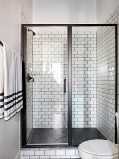 Bold black accents, crisp white tile and spa-like touches give this bathroom a clean, relaxing vibe.