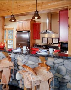 the Bar IS the kitchen! wow, those saddle stools, lol