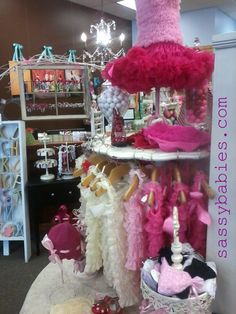 valentine goodies at the store...display  like how the little girly outfits are hung up.