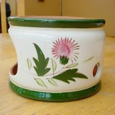 A Stangl 'Thistle' pot warmer, which goes with the coffee pot from this pattern. It still has its candle inside, and I have not attempted to remove it. If you don't have the coffeepot, it would make a