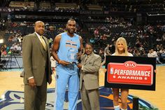 Al Jefferson of the Charlotte Bobcats receives the Kia NBA Player of the Month for March before the game against the Philadelphia 76ers at the Time Warner Cable Arena on April 12, 2014 in Charlotte, North Carolina. (Photo by Brock Williams-Smith/NBAE via Getty Images)