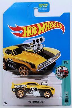 is a 2017 Treasure Hunt and in the Tooned series. The yellow muscle car has a black stripe on the top and sides. The Hot Wheels logo, and the low production symbol also… Hot Wheels Treasure Hunt, Wheel Logo, Brand Stickers, Vintage Hot Wheels, Mustang Boss, Hot Wheels Cars, Small Cars, New Toys, Ford Trucks
