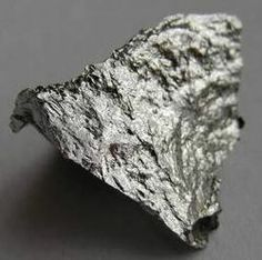 Manganese is a metallic chemical element, designated by the symbol Mn. It has the atomic number 25. It is found as a free element in nature (often in combination with iron), and in many minerals. As a free element, manganese is a metal with important industrial metal alloy uses, particularly in stainless steels, in aluminium alloys, as an additive in unleaded gasoline to boost octane rating and reduce engine knocking, and in newer alkaline batteries.