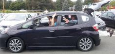 How many salesmen fit in a Honda Fit