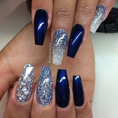 Blur and Silver Coffin Nails with studs and Glitter. The shattered look and the glittery silver nails coupled with the glossy navy blue color is another best way to wear the coffin nails this season.