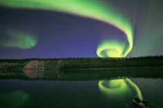 Incredible shot of a spiral Aurora Borealis! Thank God for cameras!
