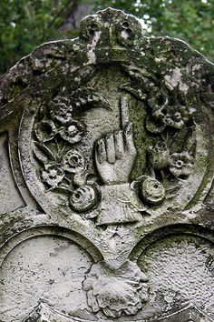 """Pointing finger on headstone in Allegheny Cemetery in Pittsburgh, PA - photo by Kimberly Powell, via genealogy.about;  """"A hand with index finger pointing upward symbolizes the hope of heaven, while a hand with forefinger pointing down represents God reaching down for the soul. ... Hands carved into gravestones represent the deceased's relationships with other human beings and with God. Cemetery hands tend to be shown doing one of four things: blessing, clasping, pointing, and praying."""""""
