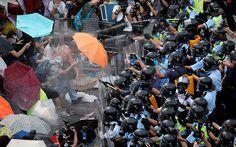 Umbrella Revolution Hong Kong, Riot police use pepper spray against protesters in Hong Kong,  Sept. 28, 2014.