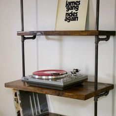 Our signature pipe bookshelf is one of our most popular hand-built items and this unit is ideal for record storage and a turntable console. This vinyl record storage shelf with turntable stand can be