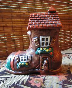 There was an old woman who lived in a shoe... or maybe some mice. VINTAGE COOKIE JAR IN GOOD CONDITION AND CLEAN. FAIRY TALES, NURSERY RHYMES, IT CAN EVEN MATCH UP PRETTY WELL WITH GINGERBREAD HOUSES OR FAERIE HOUSES.
