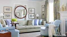 """After his client downsized to a smaller house in Summit, New Jersey, designer Kevin Isbell accommodated her 12-foot-long sofa in the living room by putting it against a wall with a doorway. To """"defuse the fact,"""" he hung her showstopping 19th-century sorcerer's mirror above it, creating the feeling of a solid wall. """"The room beyond is the family room, and we thought, 'Why do we need two entries with this compact floor plan?'"""" he says. """"We discovered this mirror and realized it was wide enough…"""