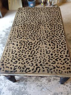 Leopard print coffee table.