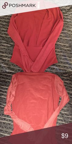 Deep plunge sheer sleeve bodysuit. Size SMALL Burnt orange bodysuit with deep v-cut in front. Bodysuit has long sheer sleeves and snaps at crotch. Tops Blouses