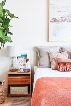 Fresh Coral – Swap in new throws and pillows for a seasonal change. Or switch up the bedside table by adding a new piece of art, no hammering required. Click through for more bedroom ideas.