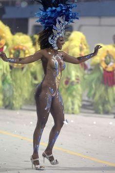 A dancer performs during the parade of Rosas de Ouro samba school in Sao Paulo, Brazil, Saturday, Feb. 18, 2012