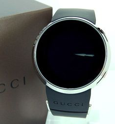 These luxury LCD watche feature a cool round white-on-black display, set behind a sturdy sapphire crystal made by Gucci. (OAP)